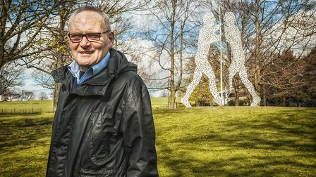 Founder and executive director Peter Murray, with Jonathan Borofsky's Molecule Man 1+1+1 Photo: Marc