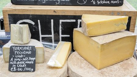 Cheese on display at The Courtyard Dairy, Settle
