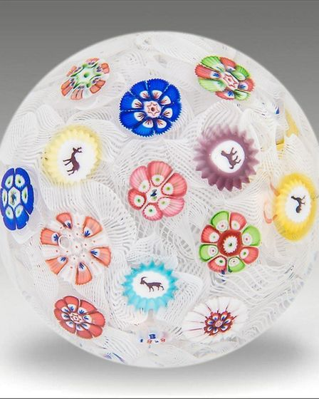 Baccarat scattered paperweight on muslin, 1848