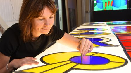 Helen Whittaker at Barley Studios, York works on panels of the stained glass window designed by Davi