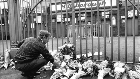 A football supporter places a wreath outside the Hillsborough Stadium