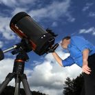 Amateur astronomer Richard Darn scans the skies with a powerful telescope Photo: Tony Bartholomew