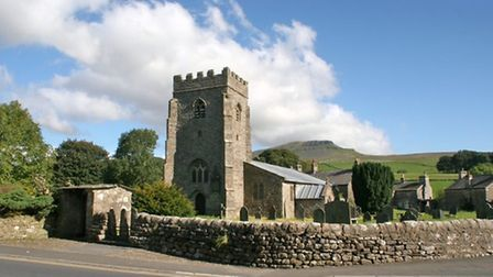 Penyghent is seen behind the church tower in Horton-in-Ribblesdale