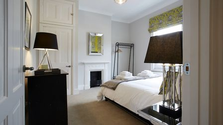 The master bedroom has a boutique hotel feel