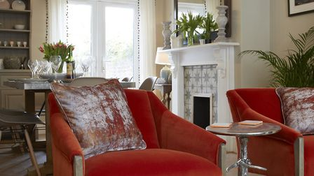 A splash of colour with bright orange chairs in the sitting room