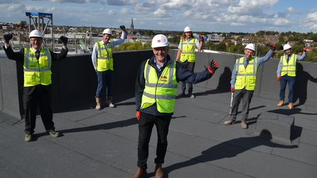 Broadland Housing and RG Carter stand on the new top floor of the apartments being built at Canary Q