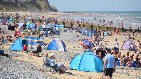 Crowds flock to Cromer beach in late summer 2020. the district council has launched a new fund to en