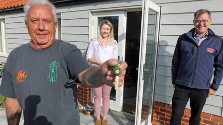 Paul Dawson, left, has become the first new affordable housing resident of a development off Holt Ro
