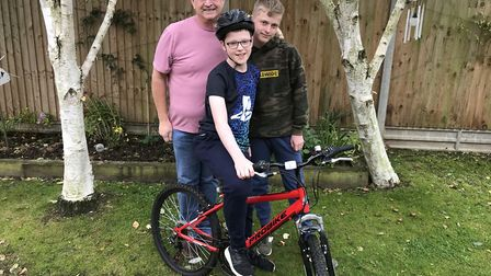 Keiran Dickerson (front), with his dad Dave and twin brother Lewis, is cycling 60 miles to raise mon