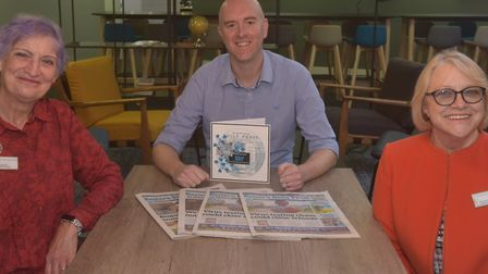 Norwich WI present EDP Editor David Powles with the 150th birthday card. Pictures: BRITTANY WOODMAN