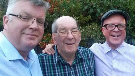 John Wellings, centre, with his sons Simon and Paul. Picture: Supplied by the family