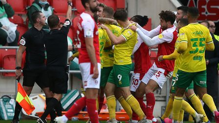 Players from both sides rush to get involved as tempers flare after Angus MacDonald of Rotherham Uni