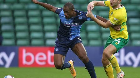 Wycombe Wanderers' substitute Uche Ikpeazu holds off Norwich City defender Ben Gibson Picture: Paul