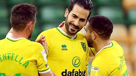 Xavi Quintilla, left, and Emi Buendia congratulate Mario Vrancic after his Wycombe winner Picture: P
