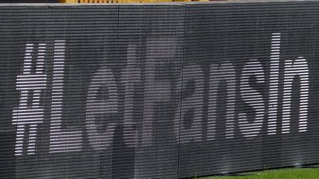 #LetFansIn is displayed on the LED boards during the Sky Bet Championship match at Carrow Road, Norw