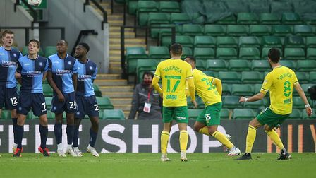 Mario Vrancic curled a superb free kick home to earn Norwich City a 2-1 Championship win against Wyc