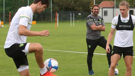 Canaries head coach Daniel Farke watching defender Timm Klose, left, during pre-season training in G