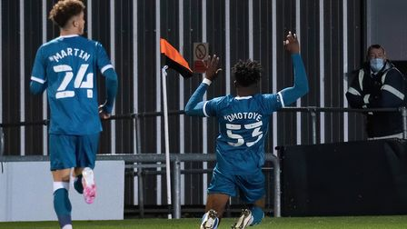 Celebration time for Tyrse Omotoye after opening the scoring for the young Canaries at Newport Pict