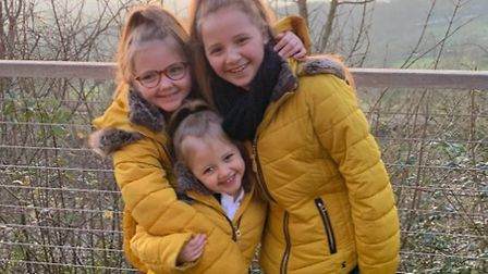Sophia Honey Adcock, six, with her sisters Alexi and Kelsi. Picture: Sammy Adcock
