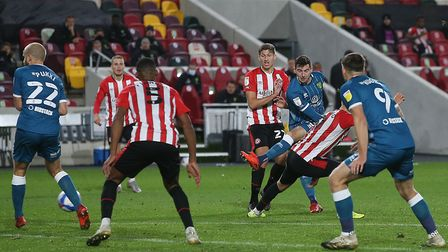 Kenny McLean's late strike was deflected into the Brentford net to earn Norwich City a point Picture