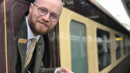 Train Manager Thomas Leonard on the Northern Belle in Norwich Station ready to take passengers for a