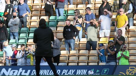 Norwich head coach Daniel Farke acknowledges the home fans at the end of the Championship 'test even