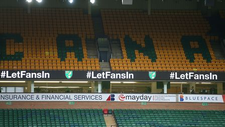 The message is loud and clear - #LetFansIn is displayed on the LED boards during the match against W