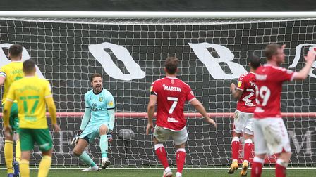 Despair for Bristol City but celebrations for Norwich City as Nahki Wells puts his spot-kick over th