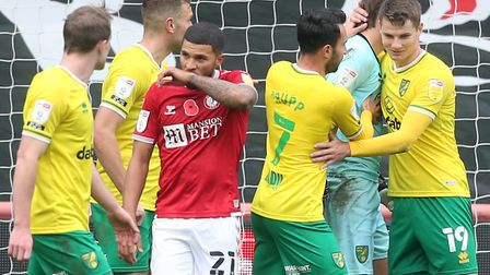 Nahki Wells faces up to his annoyed team-mates after a penalty miss, as relieved Norwich players cel
