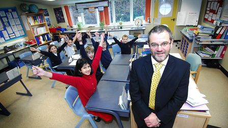 Headteacher Tim Lawes with pupils at Catton Grove Primary School in 2009. Picture: Antony Kelly