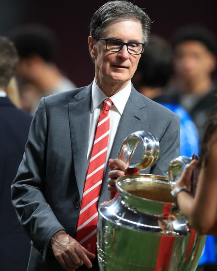Looking after the silver ... Liverpool owner John W Henry Picture: PA