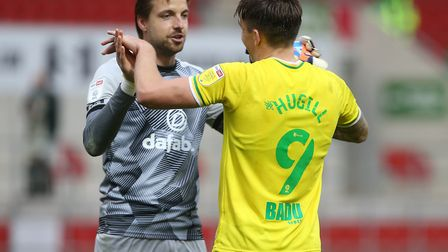 Norwich City's match-winners Tim Krul and Jordan Hugill celebrate the victory over Rotherham United.