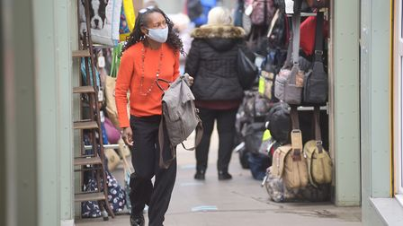 Shoppers around Norwich Market staying safe in masks. Picture: Sonya Duncan