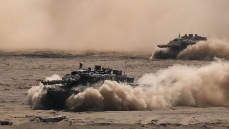 Leopard 2 main battle tanks of the Bundeswehr, the German armed forces, take part in the NATO Noble