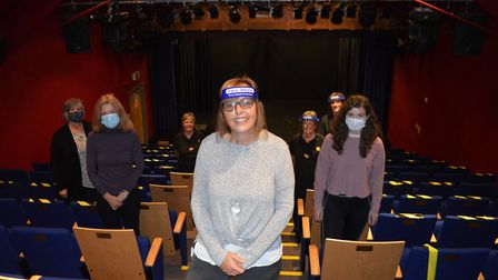 The team at Sheringham Little Theatre celebrating inside the theatre after receiving a lifeline £76,