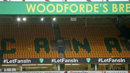 #LetFansIn is displayed in the LED boards during Norwich City's game against Wycombe Picture: Paul