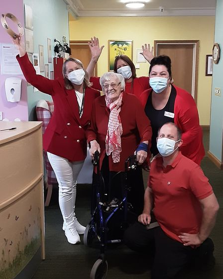 Staff with one of the residents at Harleston House care home in Lowestoft on the Butlin's themed day