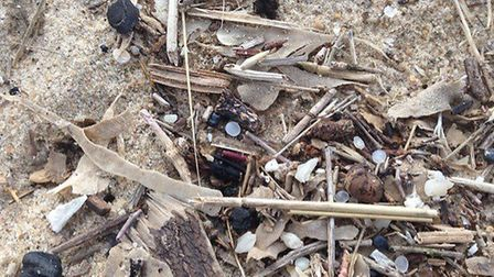 Plastic beads called Nurdles on the beach, part of the plastic haul collected from the beach between