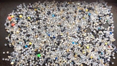 Plastic beads called nurdles, part of the plastic haul collected from the beach between Eccles and S
