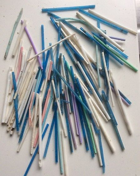 Plastic straws and plastic sticks from cotton buds. part of the plastic haul collected from the beac