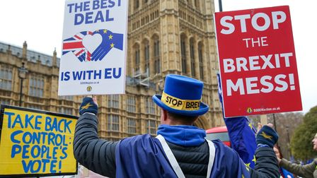 Steven Bray founder of SODEM (Stand of Defiance European Movement) holding placards during the prote