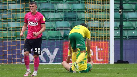 Lukas Rupp consoles Teemu Pukki after his penalty slip Picture: Paul Chesterton/Focus Images Ltd