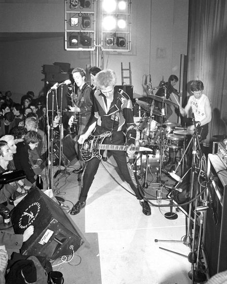 The Clash performing on stage at Harlesden Coliseum, London 11 March 1977. L-R Joe Strummer, Mick Jo