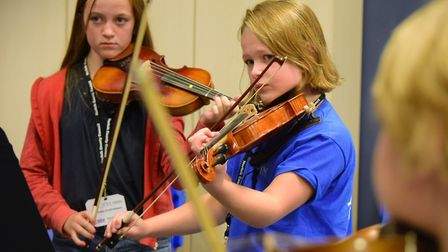 Youngsters take part in the Norfolk Centre for Young Musicians open day at City of Norwich School.