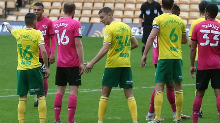 Ben Gibson (number 34) organises the Norwich City defence ahead of a Derby free-kick during the 1-0
