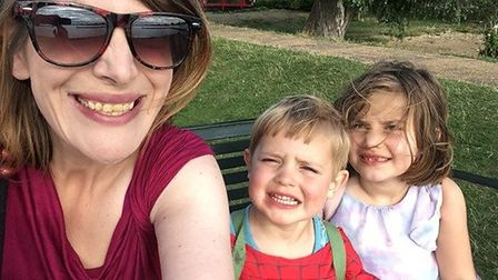 Victoria Isbell, 38, with her two children, Evangeline, 6 and Edward, 3. PHOTO: Victoria Isbell