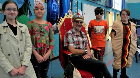 Tim Lawes with pupils in fancy dress as part of celebrations marking him stepping down after 21 year