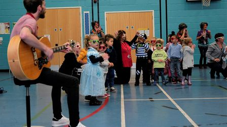 Young pupils in fancy dress take part in celebrations marking the retirement of Tim Lawes after 21 y