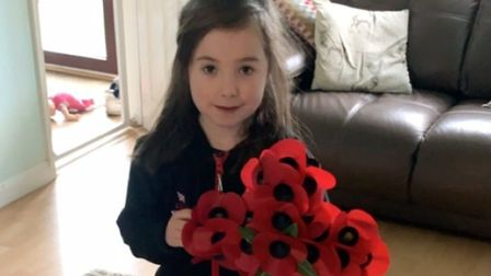 Ella-Rose Tims, seven, from Stalham, is planning a walk to raise money for the Royal British Legion.