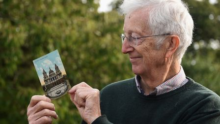 Philip Nicholson with the postcard which arrived at his property in Norwich 100 years after being po